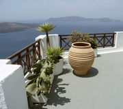 Mediterranean balcony. View from a Balcony in Oia, famous city of island Santorini, Greece Royalty Free Stock Images