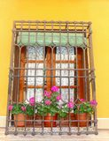 Mediterranean balcony with flowers and handicrafts curtains Royalty Free Stock Photography