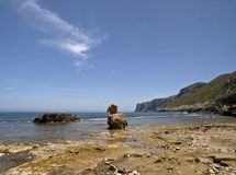 Mediterranean Beach. Beautiful mediterranean cove with some rocks on the foreground Royalty Free Stock Photos