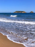 Mediterranean beach. In Estartit (Costa Brava, Spain) with Medes Islands on background Stock Images