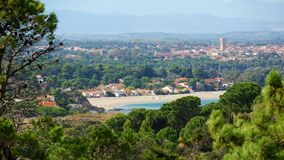 Mediterranean beach in Argeles-sur-Mer France. Mediterranean beach of the Racou in Argeles-sur-Mer with the village in background, Roussillon, Pyrenees Stock Image