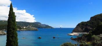 Mediterranean beach coastal marina Corfu Greece. Mediterranean beach and coastal marina in a cove at Paelokastritsa on Corfu, Greece Royalty Free Stock Photo