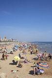 Mediterranean beach crowded with tourists Royalty Free Stock Images