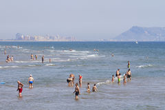 Mediterranean beach crowded with tourists Stock Image