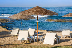 Mediterranean beach with empty sunbeds in the morning, Paphos, Cyprus Stock Image