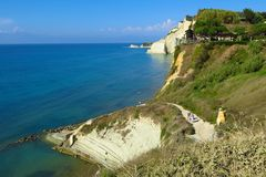 Mediterranean beach path along white cliffs to blue sea Royalty Free Stock Images