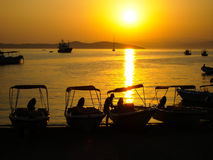 Mediterranean beach sunset - Greece romantic getaway. An image of the beautiful sunset at a Greek island with fisher boats at the seaside Royalty Free Stock Photos