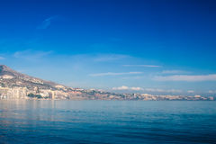 Mediterranean Beach 2. View to a Mediterranean sea at Fuengirola, Andalusia, Spain. The mountains shadow the beach hotels stock images