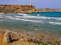 Mediterranean Bliss. Clear blue Mediterranean waters on windy day, with beach and typical rocky coastline Stock Photography