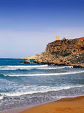 Mediterranean Bliss. Clear blue Mediterranean waters on windy day, with beach and typical rocky coastline Stock Images