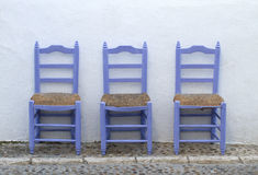 Mediterranean blue chairs alone Royalty Free Stock Image