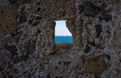 Sea view. Mediterranean blue sea view through a hole Stock Photography