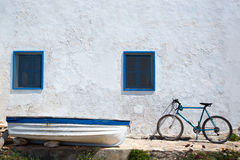 Mediterranean boat bicycle and white wall in white. And blue at Balearic Islands Stock Photography