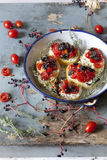 Mediterranean bruschetta with cherry tomatoes, olive and thyme Royalty Free Stock Image