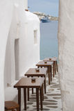 Mediterranean Cafe. Cafe in an alley leading to the sea in Santorini, Greece Stock Image