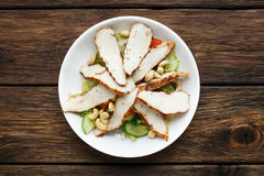 Mediterranean cashew chicken salad. Restaurant food top view. Catering, banquet food. Mediterranean cashew chicken salad.  Roast sliced chicken, turkey meat and Stock Image