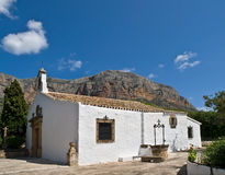 Mediterranean Chapel. Located next to a mountain. Photo taken in a sunny day with a perfect blue sky Royalty Free Stock Photography