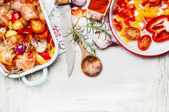 Mediterranean Chicken with colorful vegetables and sweet paprika powder in casserole , preparation on white wooden background wit stock photo