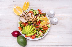 Mediterranean chicken salad with avocado . Royalty Free Stock Photo