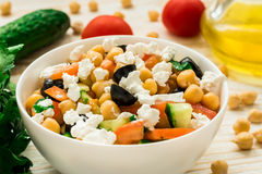 Mediterranean chickpea salad with cherry tomatoes, feta and olives Stock Photos