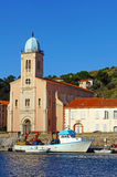 Mediterranean church with fishing boat Stock Photo