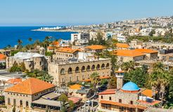 Mediterranean city historic center panorama with old church and mosque and residential buildings in the background, Biblos,. Lebanon ancient architecture bay stock photography