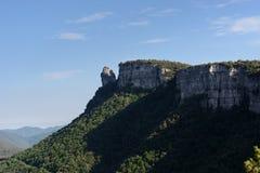 Mediterranean cliff shadows over forest Stockbilder