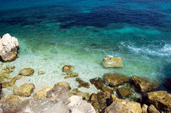 Mediterranean coast. With stones and azure water Stock Photography