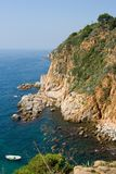 Mediterranean coast. Rocks and calm sea near Tossa. Spain Stock Images