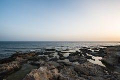 Mediterranean coast in the evening Stock Photos