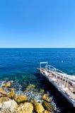 Mediterranean coast with pier royalty free stock image