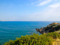Mediterranean coast. Mediterranean rocky coast with bushes tree stock photography
