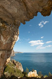Mediterranean coastline landscape with cave in Alicante. Spain Royalty Free Stock Images