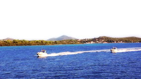 Mediterranean Coastline. Two speed boats pass by the coast of the National park Telascica on island Dugi Otok, coast near Zadar Croatia stock footage