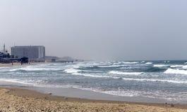 Mediterranean coastline with view on Bat - Yam Stock Photos