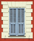 Mediterranean colourful window with blue shutters Royalty Free Stock Images