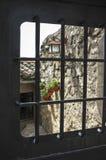 Mediterranean courtyard door with flowerpots and lantern Stock Image