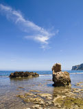 Mediterranean Cove. Beautiful mediterranean cove with some rocks on the foreground Stock Images