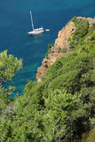 Mediterranean creek with a sailing boat Royalty Free Stock Images