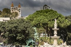 Fountain of the Duomo Cathedral with the Santuario della Madonna di Montalto royalty free stock photo