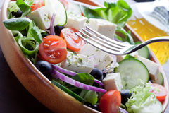 Mediterranean Cuisine. Delicious and fresh greek style salad Royalty Free Stock Images