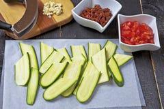 Mediterranean cuisine. Fresh Mediterranean ingredients for an Italian zucchini salad Royalty Free Stock Photos