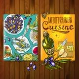 Mediterranean cuisine. Beautiful hand drawn flayers mediterranean cuisine on the wood texture Royalty Free Stock Photo