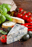 Mediterranean cuisine: blue cheese, tomatoes, olives, basil plan Royalty Free Stock Photo