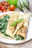 Mediterranean cuisine: crepes stuffed with cheese and spinach Stock Photo