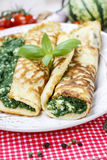 Mediterranean cuisine: crepes stuffed with cheese and spinach Royalty Free Stock Images