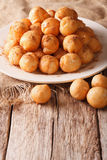 Mediterranean cuisine: fried donuts with honey and cinnamon clos Royalty Free Stock Image