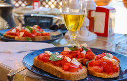 Mediterranean cuisine restaurant  - sandwiches with tomatoes and Stock Photography