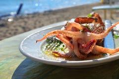 Mediterranean cuisine. Sea food. Stuffed squid Royalty Free Stock Photography