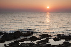 A new day. Mediterranean dawn over a rocky seascape Stock Photo